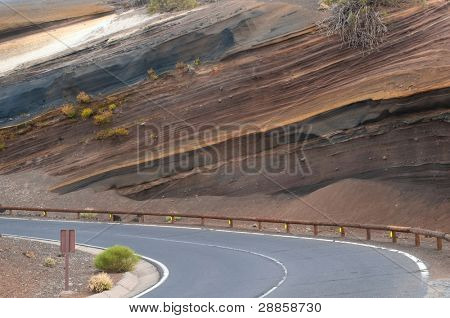 Road in muti-layered colorful coil at Tenerife island, El Teide National Park, Spain