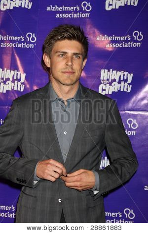 LOS ANGELES - JAN 13:  Chris Lowell arrives at  the