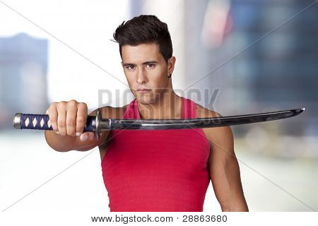 Young warrior holding a ninja sword