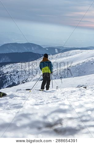 A Child Skier Skiing On