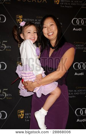 LOS ANGELES - JAN 14:  Aubrey Anderson Emmons, and mother arrives at  the BAFTA Award Season Tea Party 2012 at Four Seaons Hotel on January 14, 2012 in Beverly Hills, CA