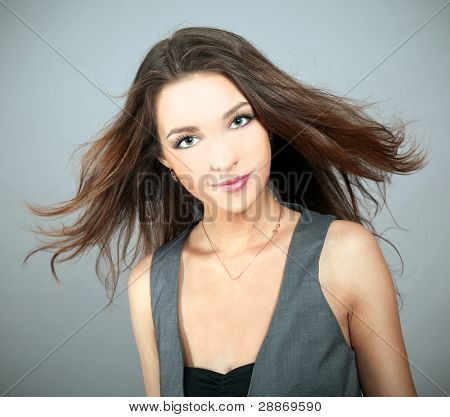 Gorgeous young woman with beautiful long brown hairs