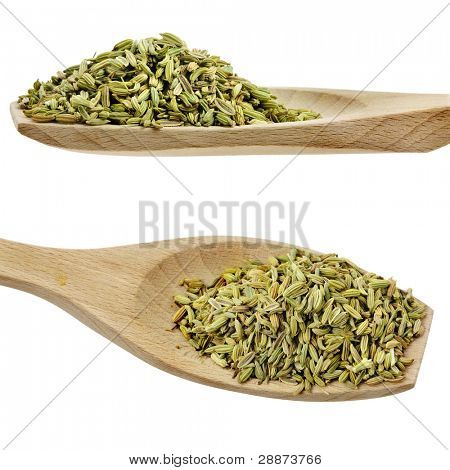 cumin seed spices on wooden spoons isolated on a white background