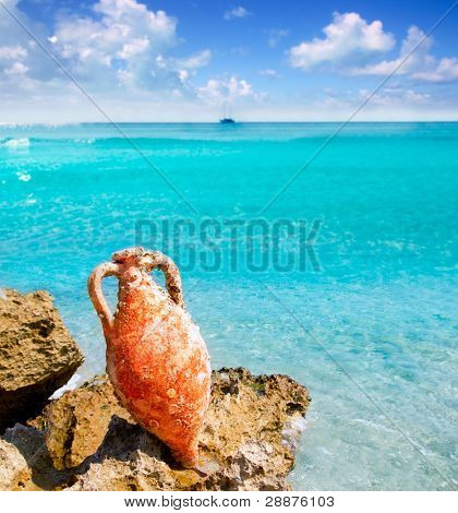 Amphora from roman culture on mediterranean turquoise beach in Spain