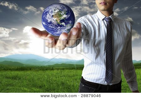 holding a glowing earth globe in his hand
