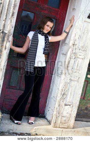 Tween In An Old Doorway