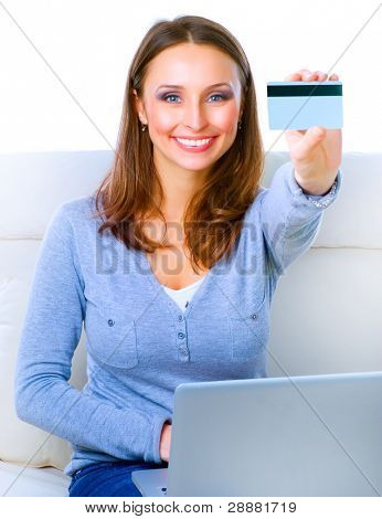 Smiling Woman shopping online with credit card and computer.Internet Shopping