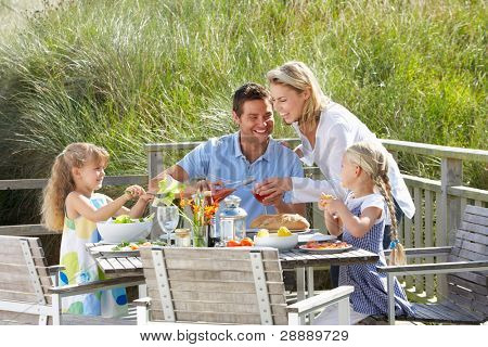 Family on vacation eating outdoors