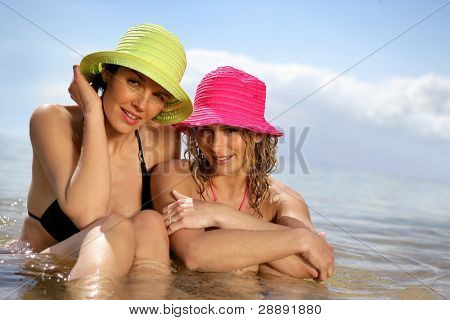 Women swimming together