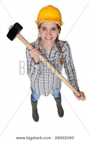 Tradeswoman holding a mallet