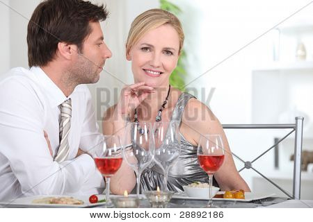 Couple in restaurant having romantic meal