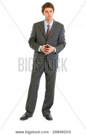 Full Length Portrait Of Confident Modern Businessman