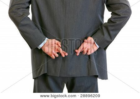 Closeup On Hands With Crossed Fingers Behind Businessman Back