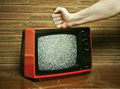 Fist smashing a TV