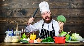 Culinary Recipe Concept. Man Bearded Hipster Cooking Fresh Vegetables. Freshest Possible Ingredients poster