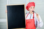 Devoted To Cooking And Food Preparation. Cute Girl Licking Spoon At Blackboard. Master Cook Giving C poster