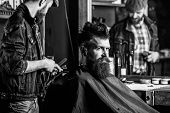 Barber With Clipper Styling Hair Of Brutal Bearded Client. Hipster Client Getting Haircut. Hipster L poster