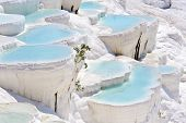 Blue cyan water travertine pools at ancient Hierapolis, now Pamukkale, Turkey