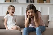 Stressed Mother Feeling Desperate About Screaming Stubborn Kid Daughter Tantrum poster