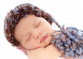 image of sleeping baby  - Newborn baby in a hat on white background - JPG