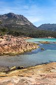 View Across Honeymoon Bay Towards The hazards Mountain Range. The Area Around Coles Bay Has Beauti poster