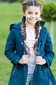 Spring Fashion For Little Girl Outdoor. Little Girl With Trendy Hairstyle In Park. Autumn Fashion. H poster