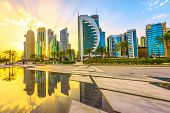 Scenary Of Doha West Bay Skyline At Sunset Light Reflecting In The Water Of Park In Downtown. Modern poster