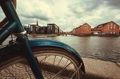 River And Cityscape With Old Buildings And Parked Bicycle In Copenhagen, Denmark. Danish Capital Und poster