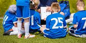 Coach Coaching Kids Soccer Team. Youth Football Team With Coach At The Soccer Stadium. Boys Listenin poster