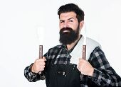 Best Barbecue Cookware. Bearded Man Holding Barbecue Tools In Hands. Grill Cook Using Spatula And Ba poster
