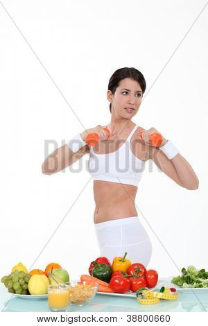 Woman keeping fit and eating healthily