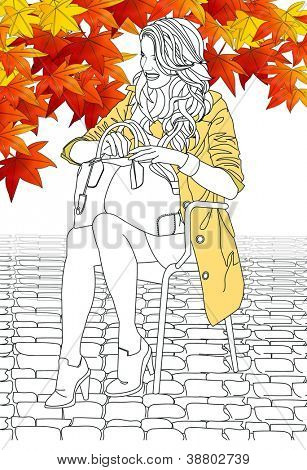 Beautifully Elegant Autumnal Fashion - posing attractive young model with a brown trench coat and a hand bag on a colorful maple tree and white background