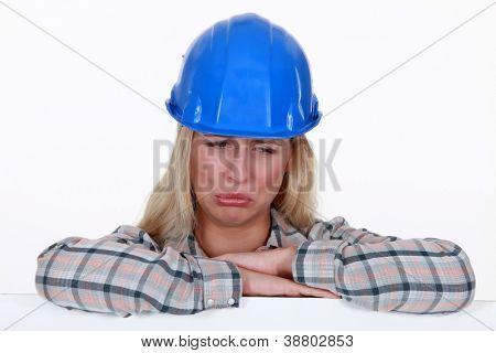 A pouting tradeswoman