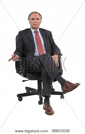 Businessman sitting in a swivel chair