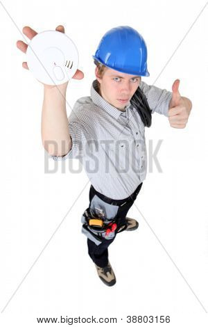 Tradesman approving of the use of smoke detectors