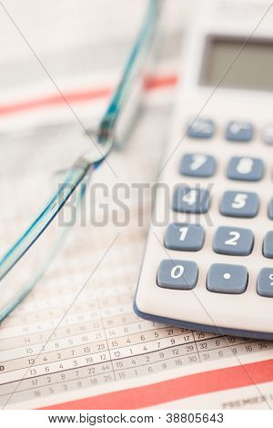Glasses and calculator on maths tables