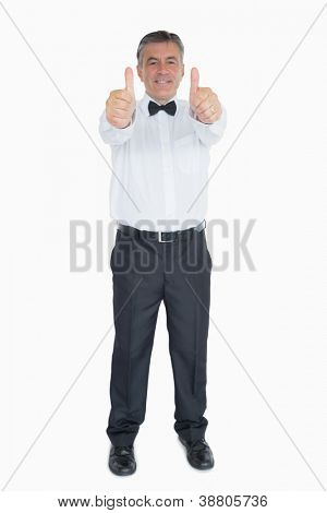 Laughing man in suit showing both thumbs up