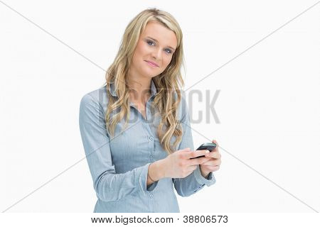 Smiling woman texting on her smartphone
