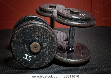 An old but well used set of dumbbells at the gym.