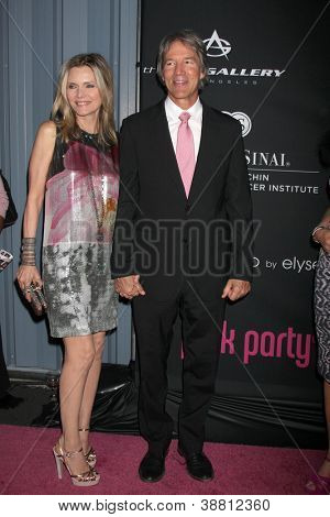 "LOS ANGELES - OCT 26:  Michelle Pfeiffer, David E. Kelley arrives at ""The Pink Party '12"" at Hanger 8 on October 26, 2012 in Santa Monica, CA"