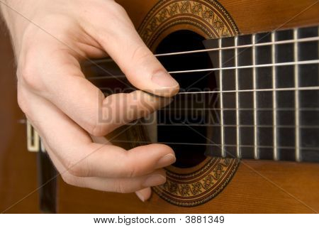 Guitar Player\'S Right Hand Picking The Strings
