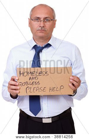 Depressed jobless and homeless senior businessman holding a cardboard and asking about help, isolated on white background