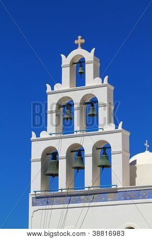 White bell tower of a church St. Irene of Oia, Santorini, Greece.