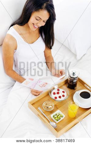 Happy mothers day breakfast in bed mum with card and tray of delicious food