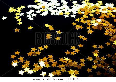 Golden stars on a black background