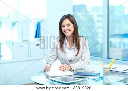 Portrait of young female looking at camera while checking proficiency test