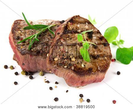 Grilled bbq steaks on white background