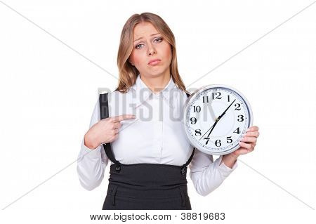 sad businesswoman pointing at the clock. isolated on white background
