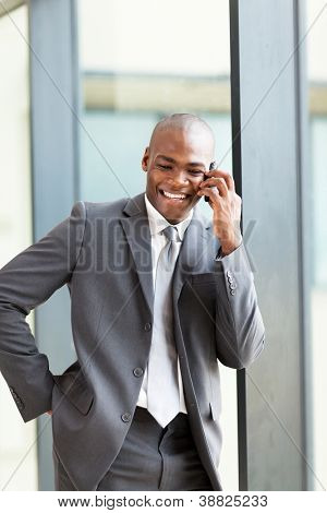 happy african american business executive talking on cell phone