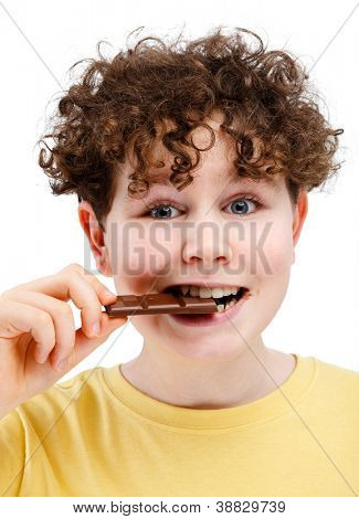 Young boy eating bar of chocolate isolated on white background